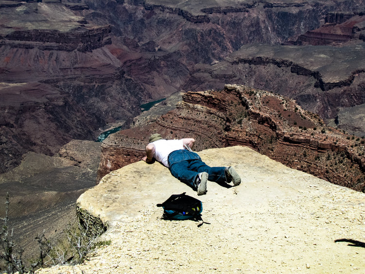 Looking over a ledge during a hike around the Grand Canyon