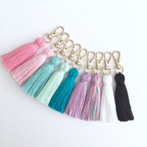 Original Tiny Tassel from Haute Pink Fluff via Etsy- Color code the keys with these little cuties.