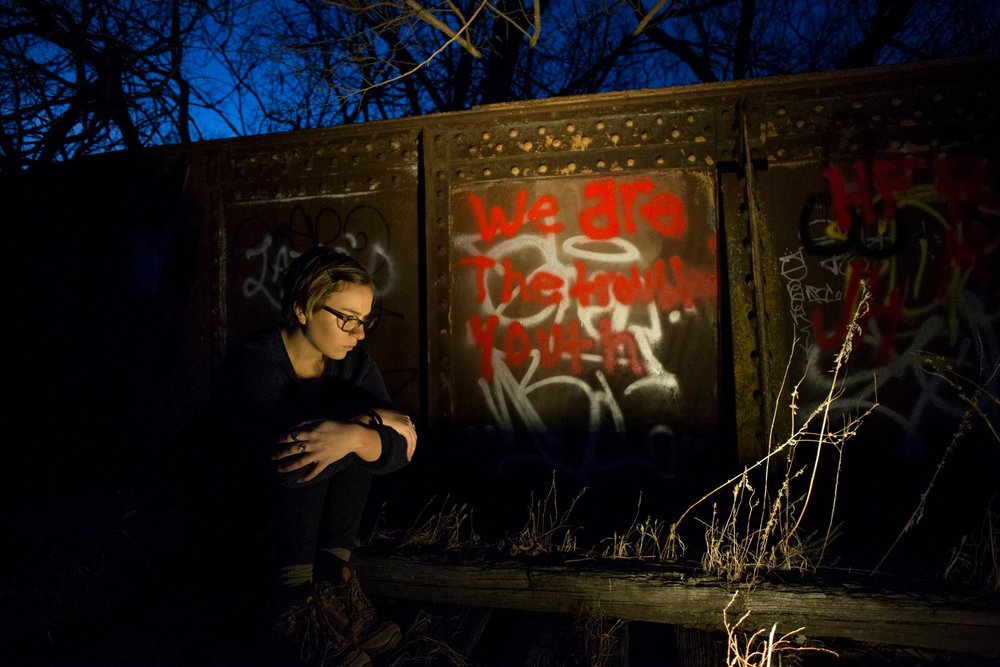 """Self-portrait at the site of the Rock Island Train Wreck, where 11 people died in 1894. The graffiti illuminated here reads, """"We are the troubled youth."""""""