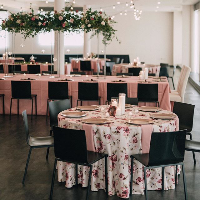 These fun linens from @uniqueeventsiowa were the perfect touch for Jenna and Matt's wedding day! . . . Photo: @jennamahr Venue: @eastbankvenue Floral: @hydrangeabloomia Linens: @uniqueeventsiowa Table numbers: @paintingforcheese
