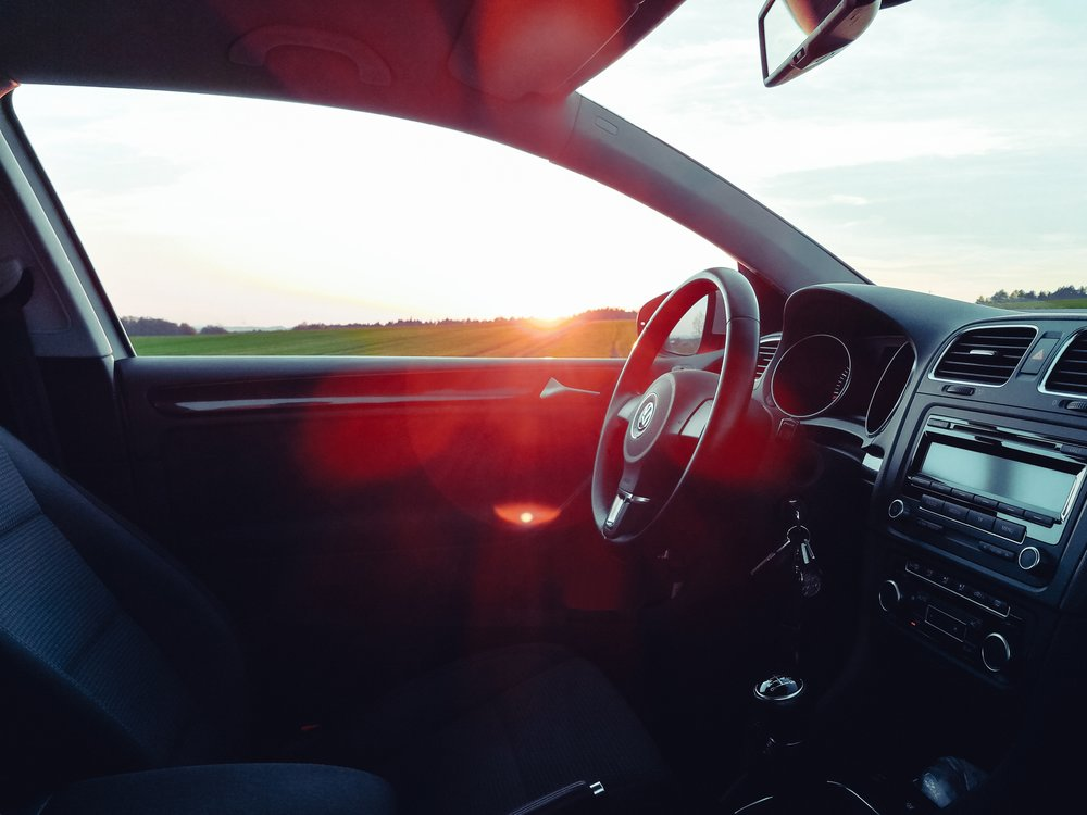 Photograph: Inside of a car showing empty front seat and steering wheel.