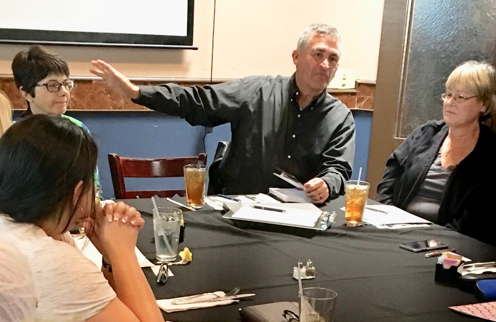Tony Martinez talks strategy at one of the first organizing meetings of WE'RE IN. His experience would later convince him to run for office representing New Mexico's 2nd Congressional District. -