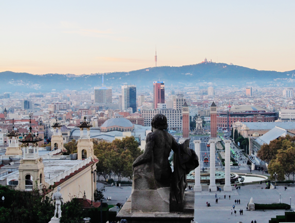 A statue looks out on Barcelona, Spain