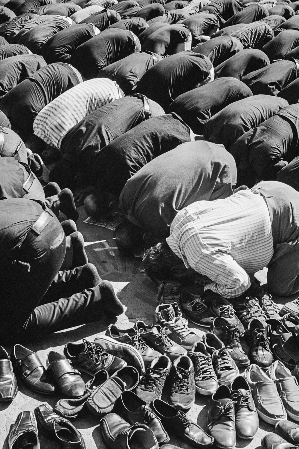 Los Angeles, California, 2016. Men praying after a procession in commemoration of Husayn ibn Ali.