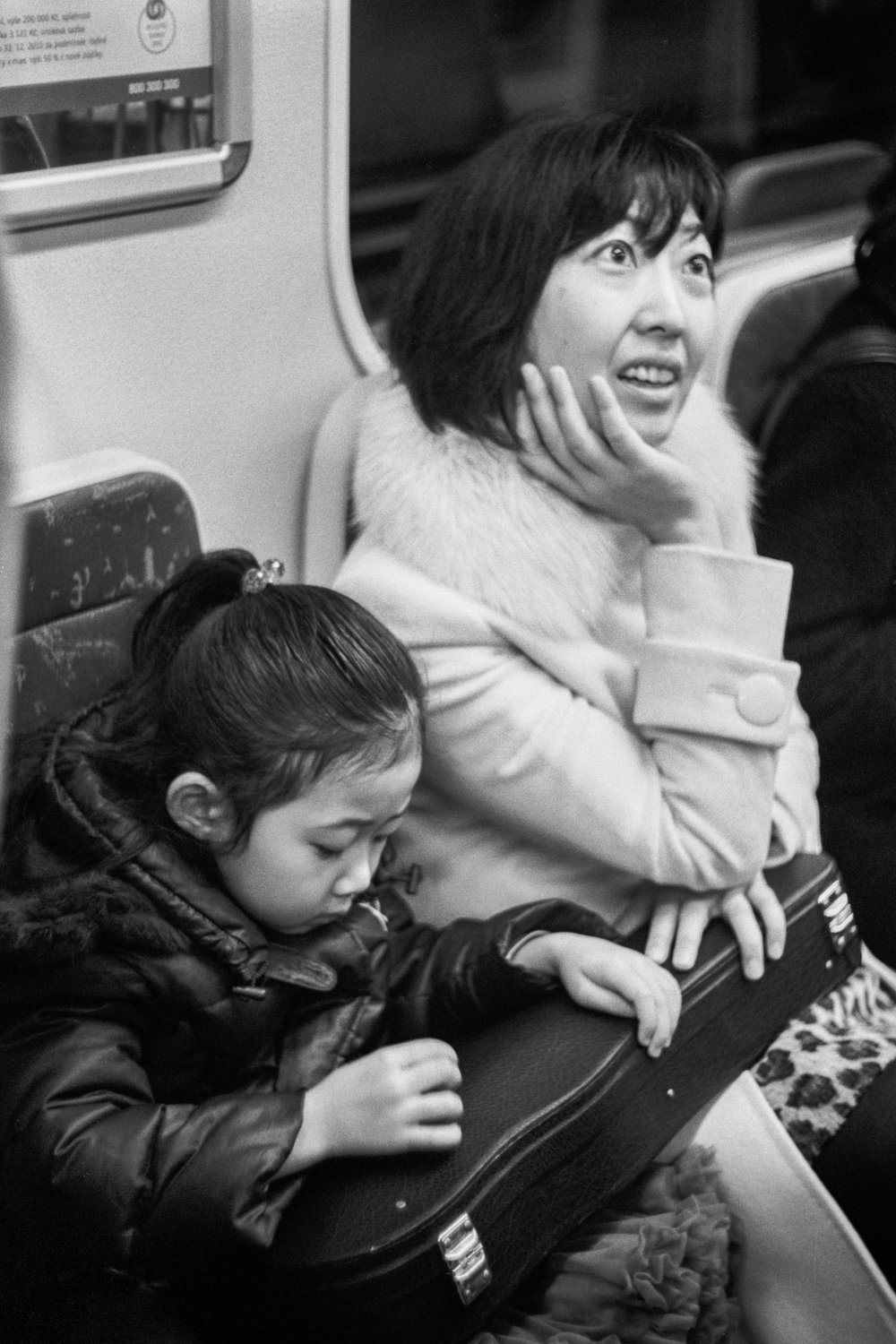 A mother and daughter on the metro, Prague, Czech Republic, 2015.