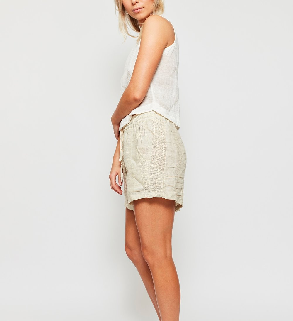 The Crop Cami  features a relaxed silhouette complete with a high neckline and a scolloped hem, It's styles back with the Draw Tie Leisure Shorts which take the form of a textured, vertical stripe with side pockets and a natural draw cord.  Made in Australia
