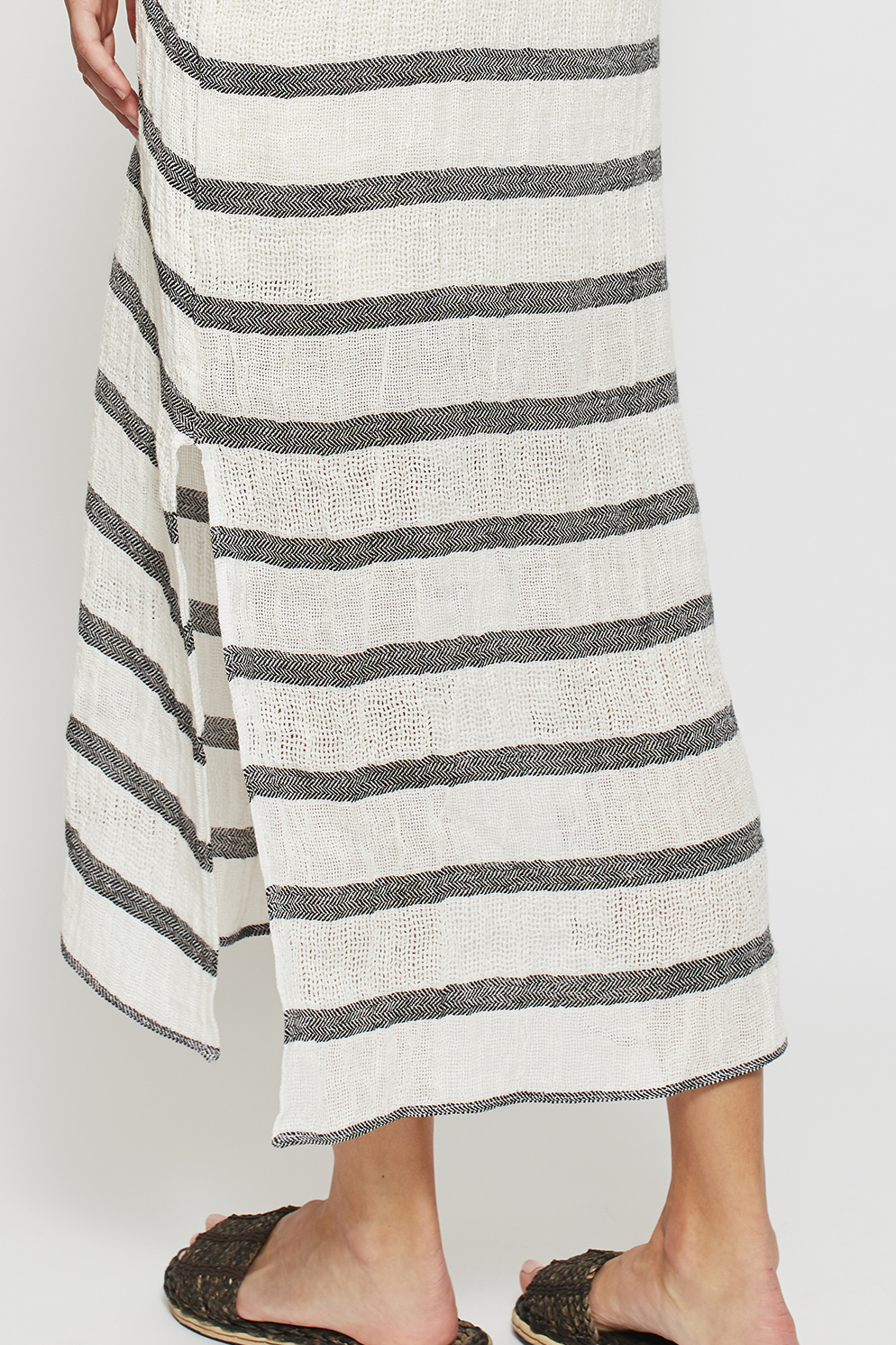 This garment also features a horizontal stripe with an intricate chevron weave, giving the kaftan it's beautiful, textural finish. Each garment may vary slightly in relation to stripe placement, as each item is cut individually, making them all moderately unique.