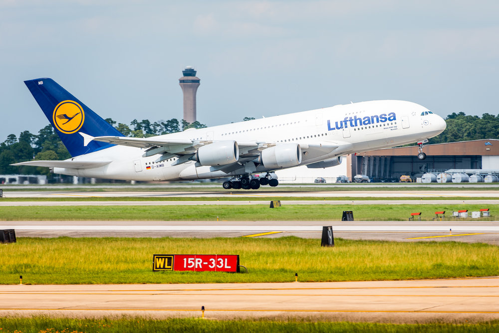 Lufthansa Airbus A380-800 taking off with the main IAH control tower in the background. This is a daily flight between Houston and Frankfurt, Germany