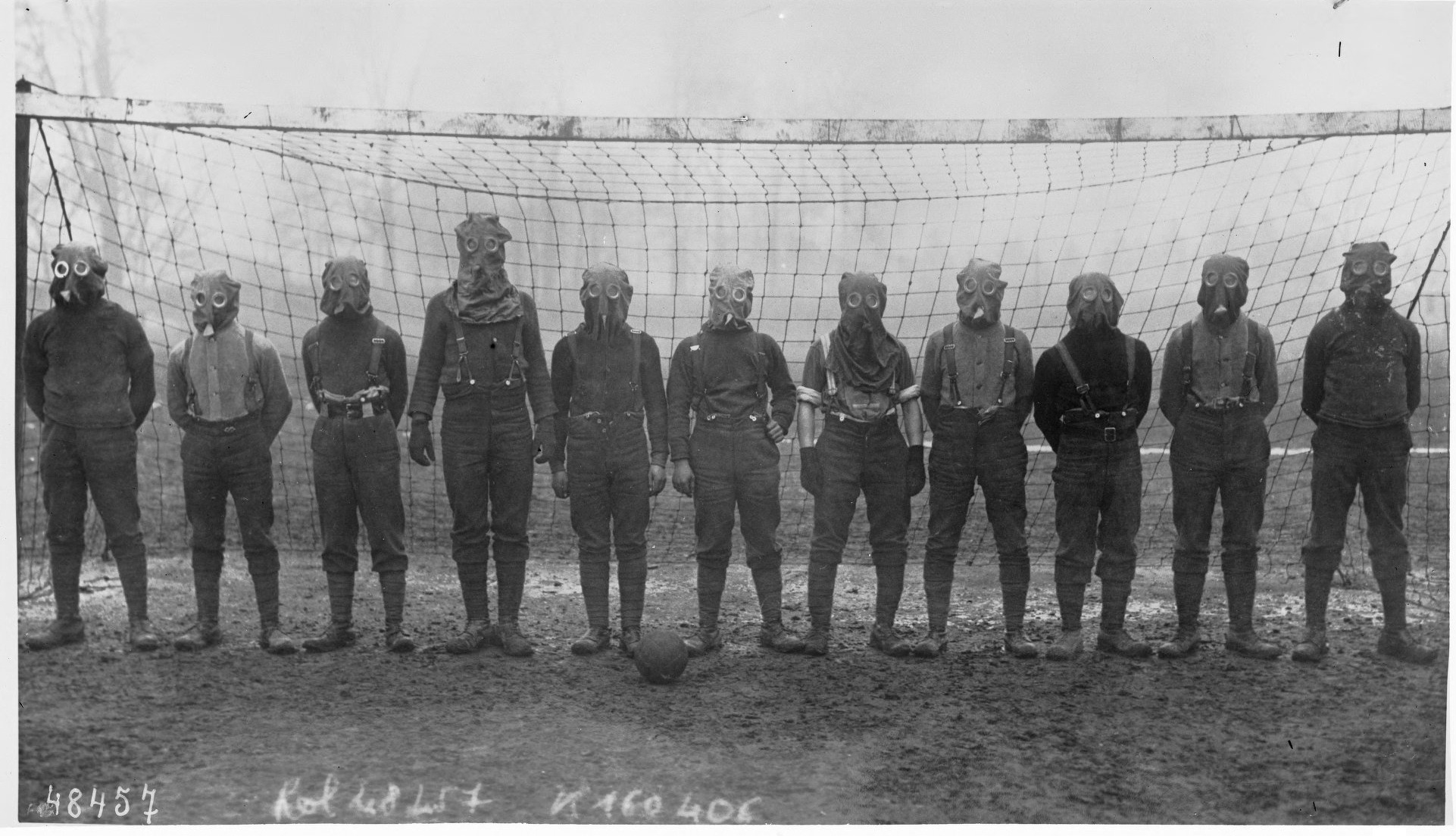 Soccer team of British soldiers with gas masks, World War I, somewhere in Northern France, 1916.