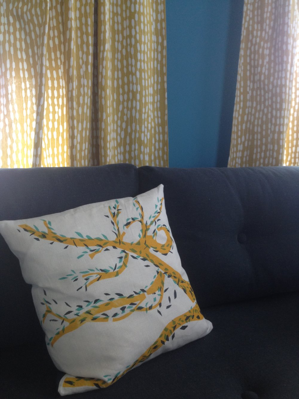 Liz's cushion in her blue & yellow home office.