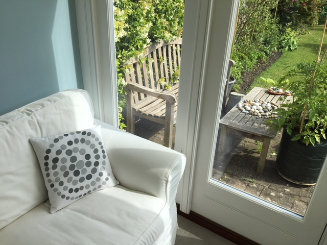 In complete contrast to the first design was this beautifully subtle print which was based on a stone sculpture that featured 76 perfectly round pebbles. The repetitive cutting of the circles pushed him to the limit but seeing this photo of the cushion in a beautiful garden room I think it was definitely worth it!