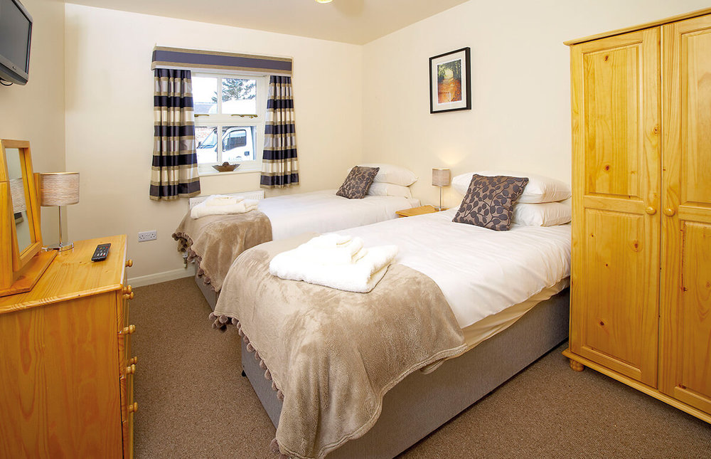 Bainton - A ground floor bedroom which also forms part of our 'family room'.  Bainton has a compact shower room and is offered at slightly cheaper rate than the majority of our rooms.  Choose double or twin beds.BOOK NOW >
