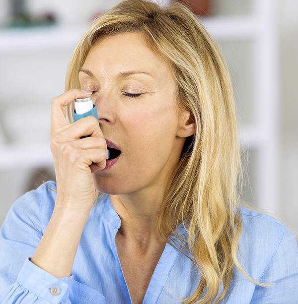 05 Inhaler stock-photo-woman-with-asthma-using-an-asthma-inhaler-464183390 copy.jpg