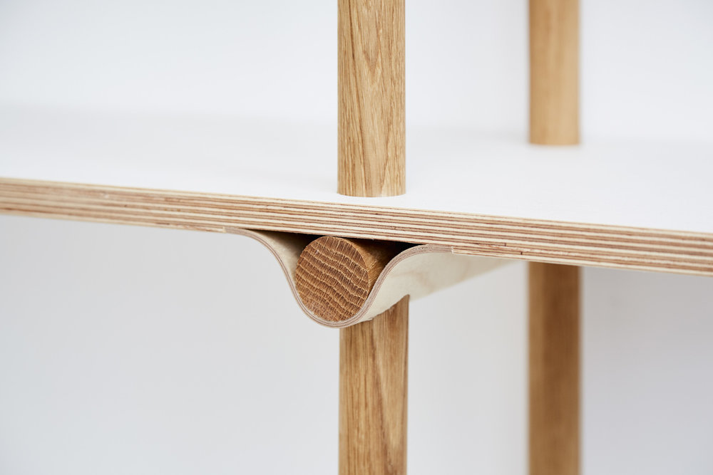 Shelving system with birch plywood shelf and curved birch plywood joint detail.
