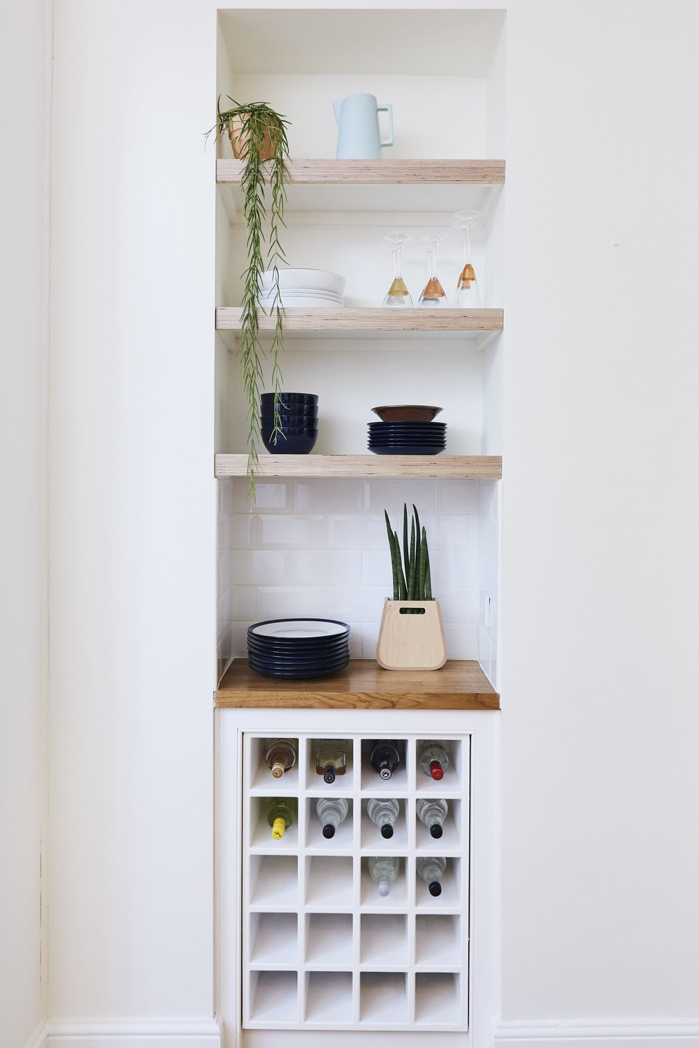Chunky fitted plywood shelving designed to accommodate Cass's selection of glasses and dishes. Discover Lozi's full range of storage solutions in the  Bespoke Storage  section of the website.