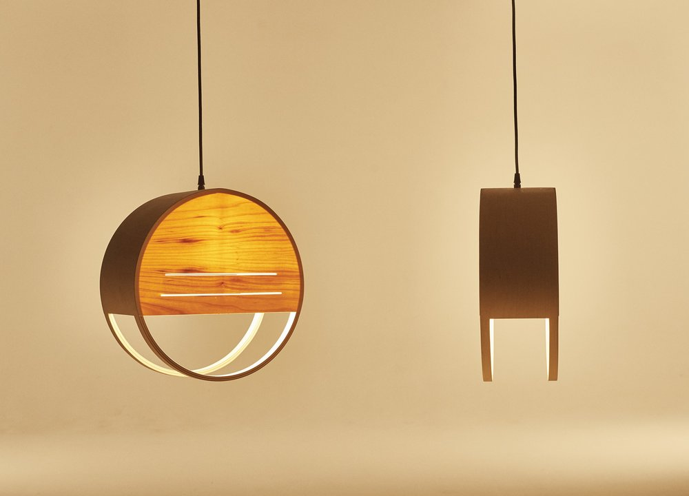 The original sunset lamp, with plywood sides. The entire shape was made by vacuum pressing a circle, then cutting out the bottom before attaching the veneer to the front and back.