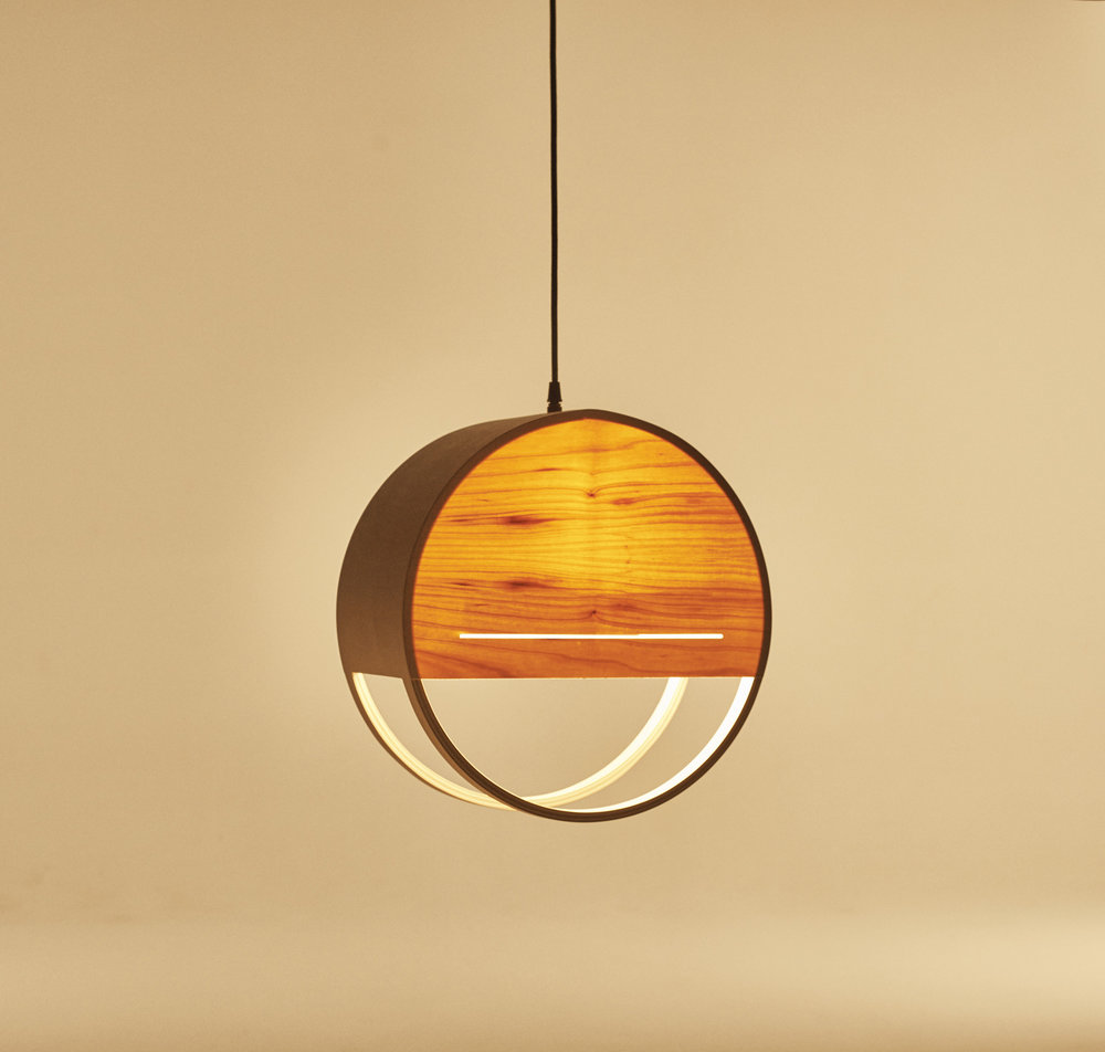 Lozi's plywood and pine veneer Sunset Lamp gives off a warming glow.