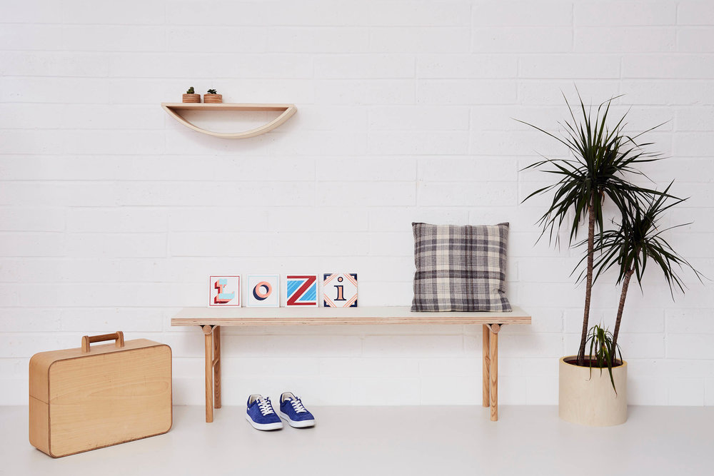 Lozi's light plywood bench features a curved solid oak joint.