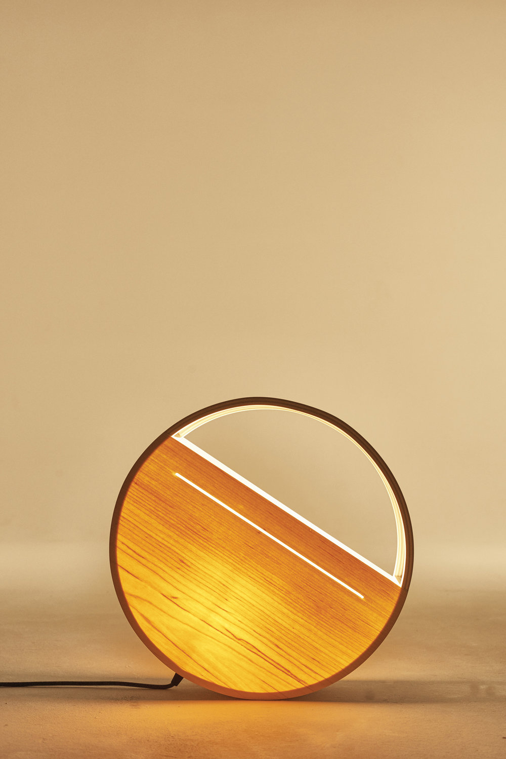 Lozi's beautiful Sunset lamp, made from birch plywood and pine veneer