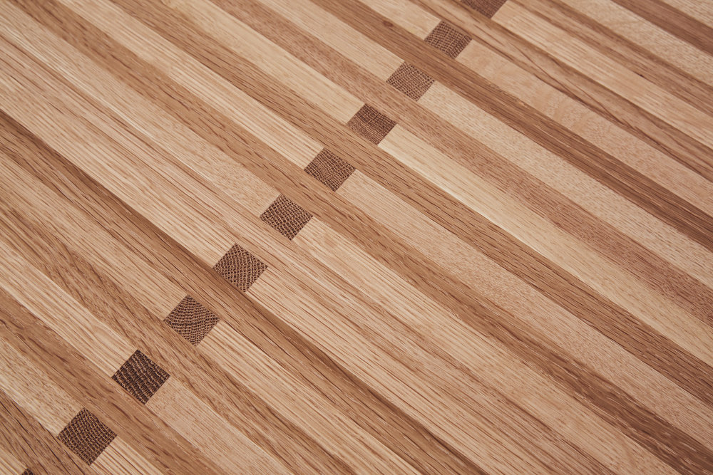 The stunning wood pattern detail, created by finger jointing strips of solid oak.