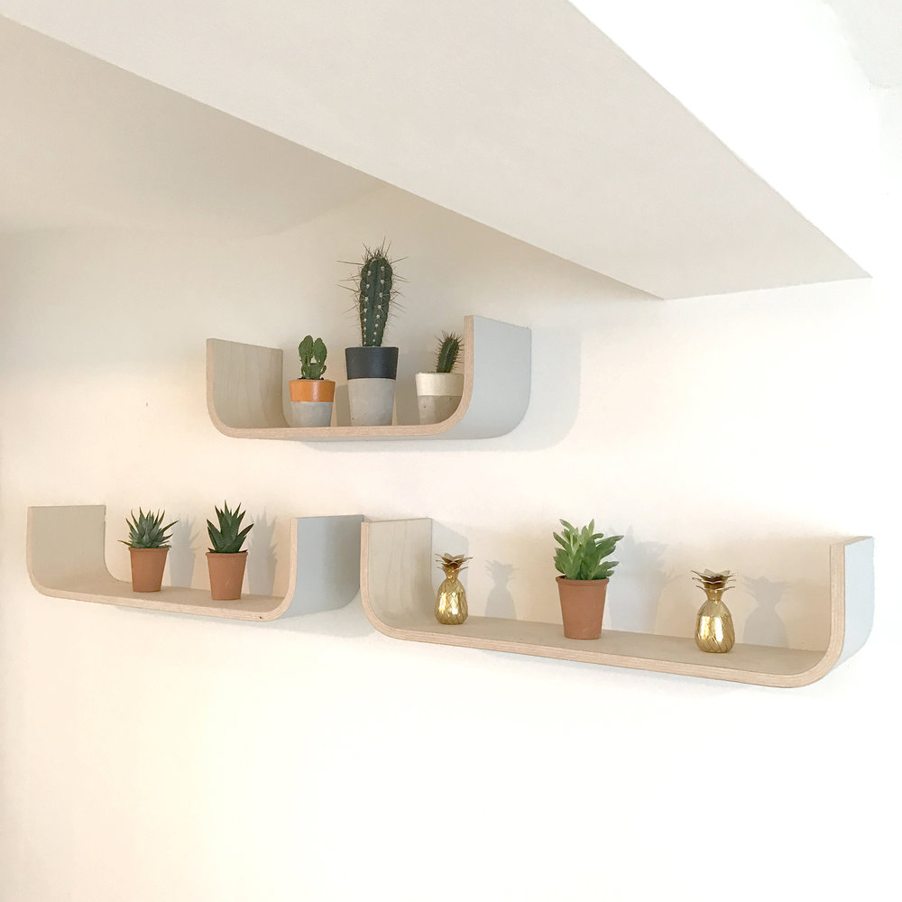 Painted U Shelves add the finishing touches and provide open plan storage.