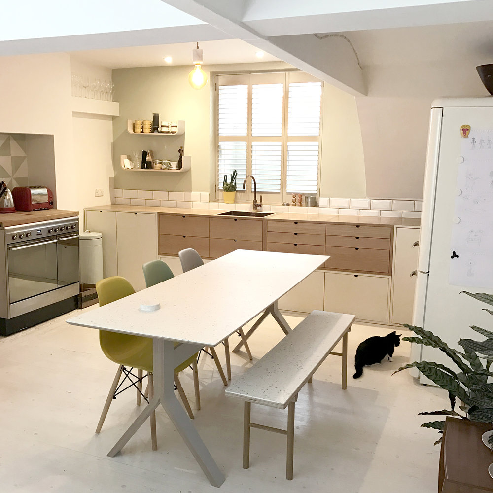 The kitchen installed and set up in brighton, with a bespoke Sea table and matching bench.