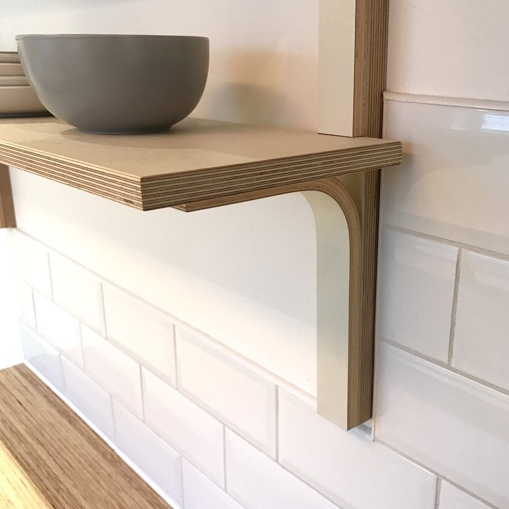 A close up detail of the curved plywood joint on Georgina's bespoke open plan shelving system.