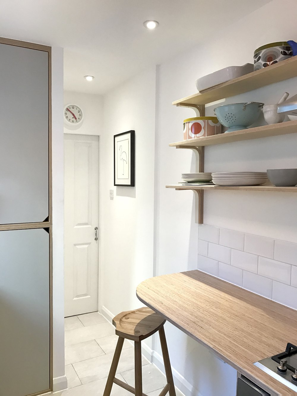 A close up of Georgina's bespoke shelves in her kitchen in Richmond, designed by Lozi