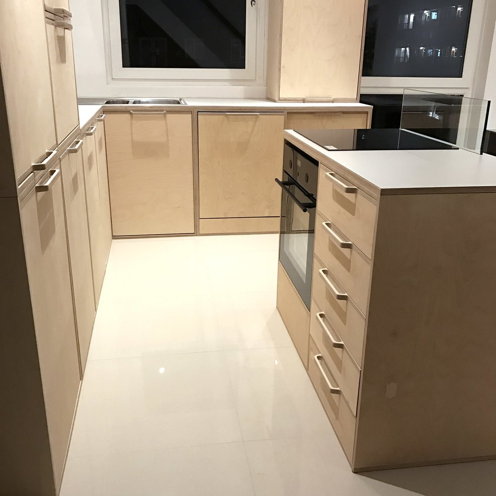 A detail of the extensive made to measure cabinets seen in this kitchen.