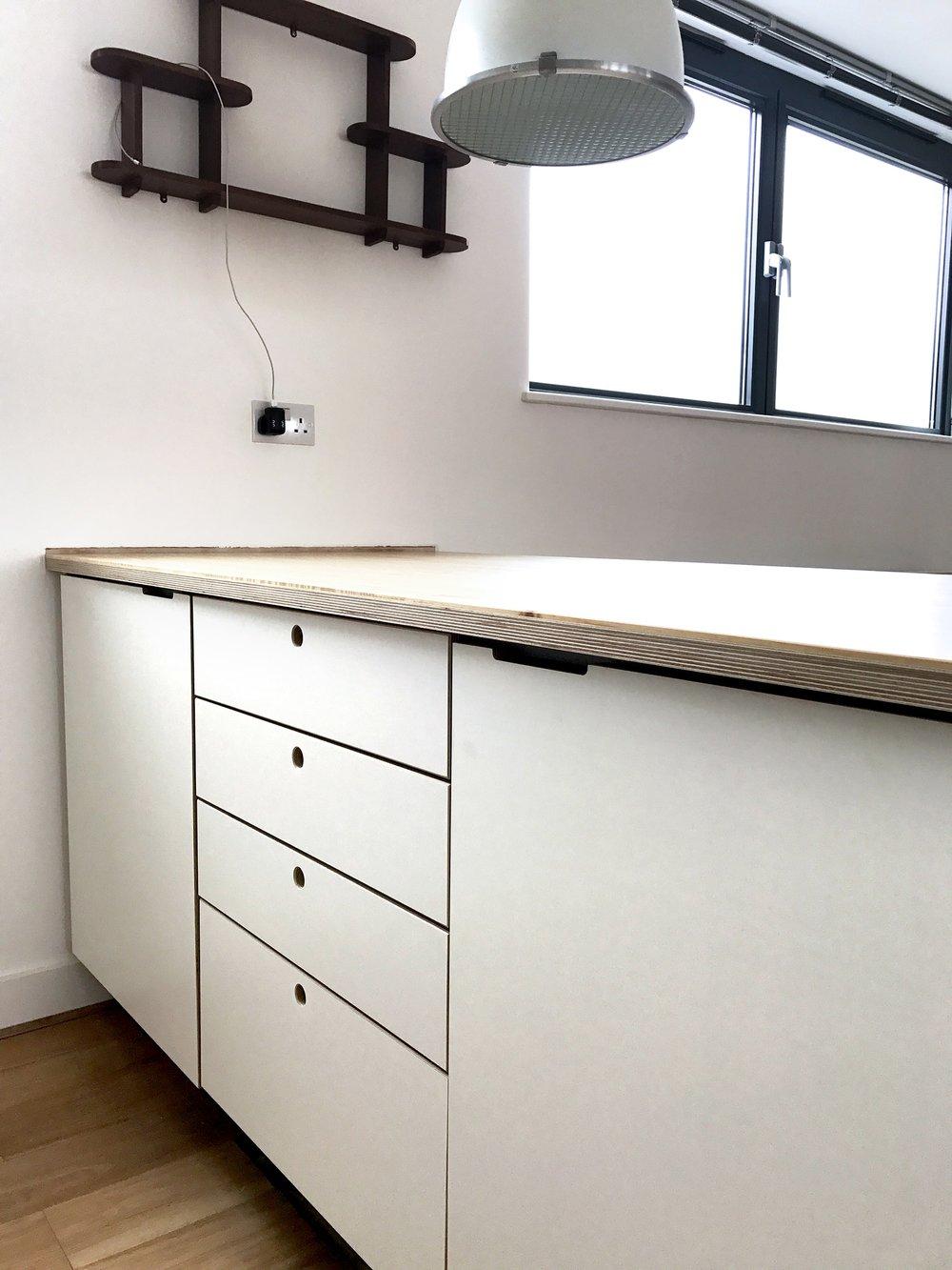 Ample storage hidden inside the kitchen island.