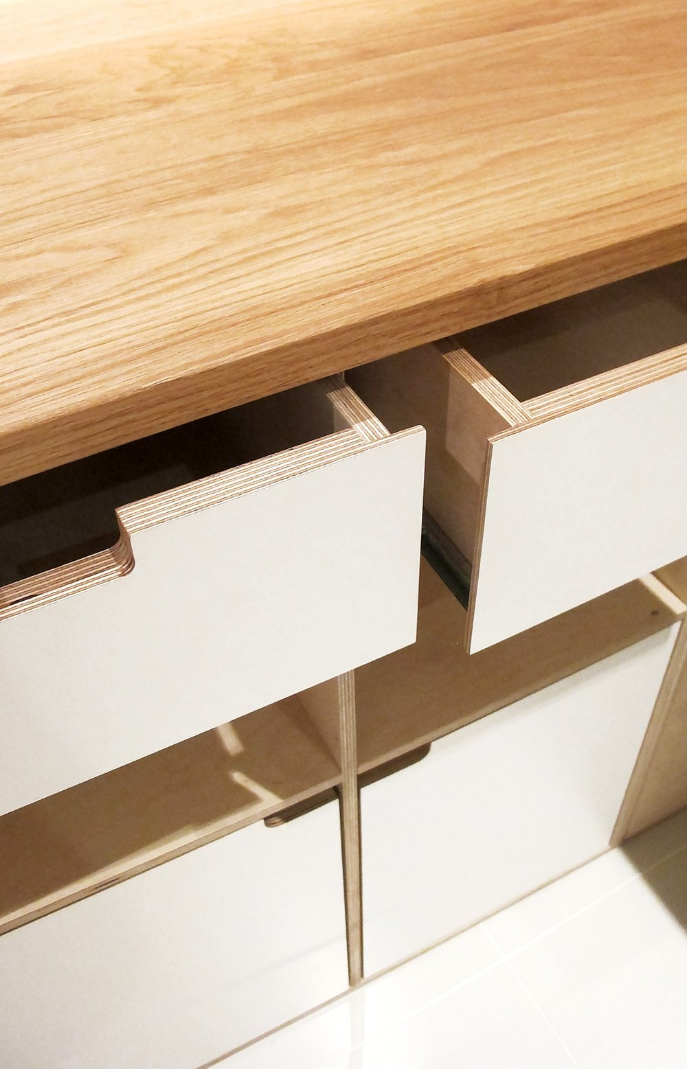 Cupboards are fitted with shelves and soft close drawers made to our client's exact specifications.
