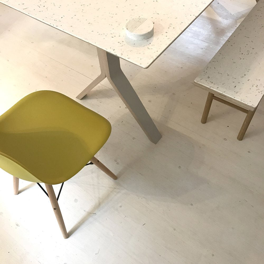A detail view of the bespoke Smile Plastics surface used on the Sea table and bench.
