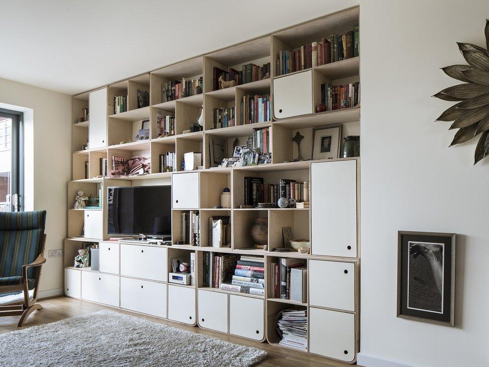 Full view of Svett's birch plywood bespoke modular shelving in Hackney London by Lozi