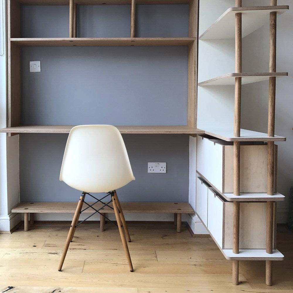 Ben's new desk space, hidden behind the bookshelves for when he doesn't need it.