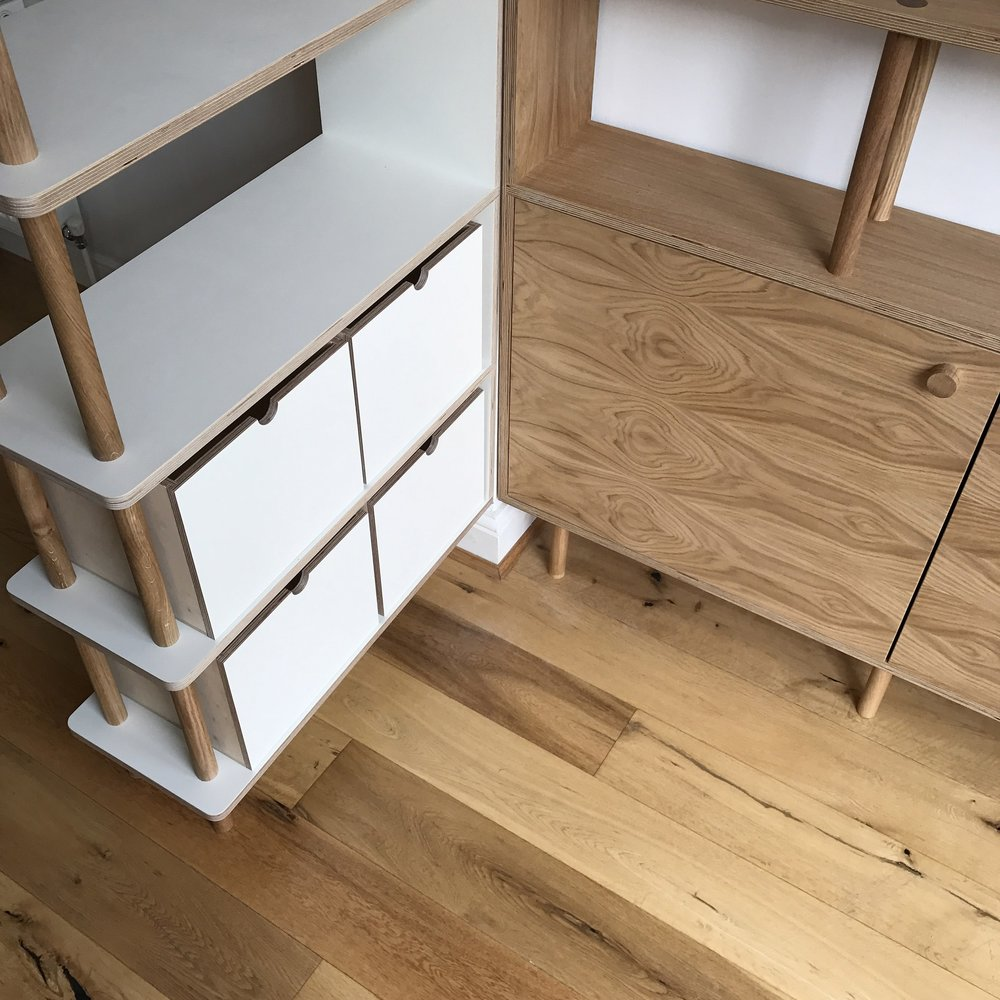 The bespoke plywood boxes, ideal for storing unattractive but essential items like computer cables.
