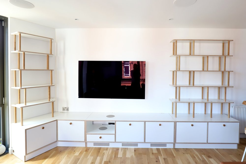 Front view of Patrick's laminated plywood and oak media unit in Bermondsey London by Lozi