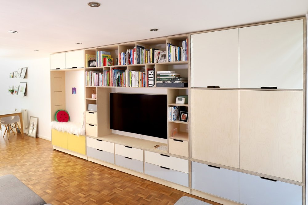 The long media unit becomes the focal point of the family room.