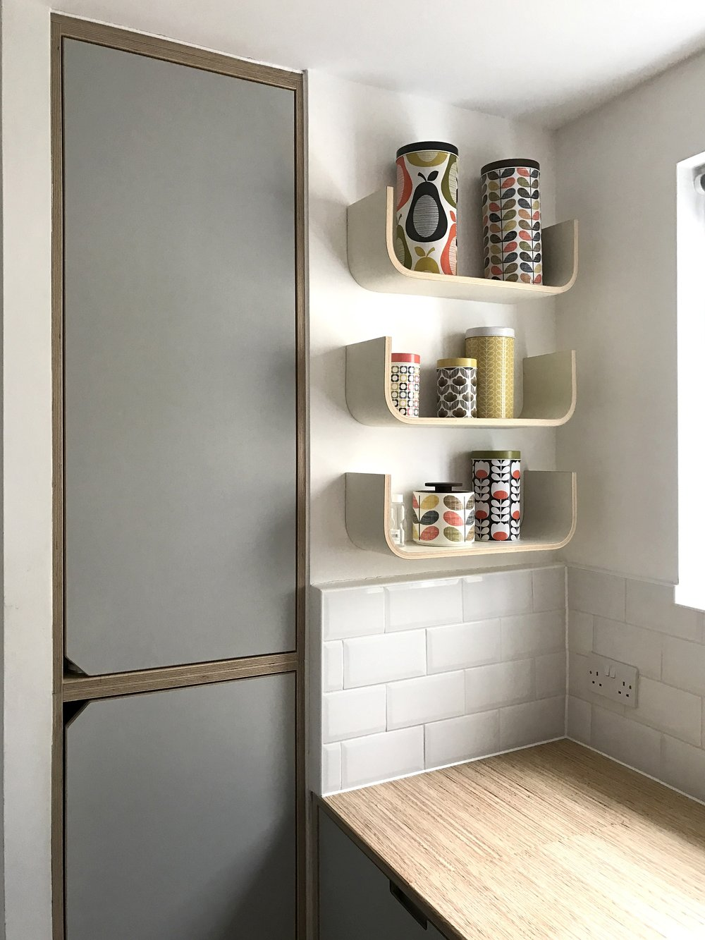 A set of medium size U shelves in Georgina's Richmond kitchen, painted a bespoke grey and with extra high sides.
