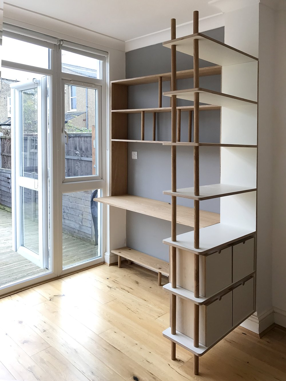 Right side of Ben's solid oak and plywood bespoke shelving in Hackney London by Lozi