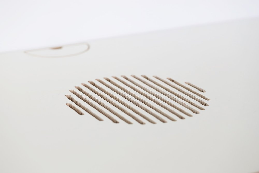 A ventilation hole and wire slot.