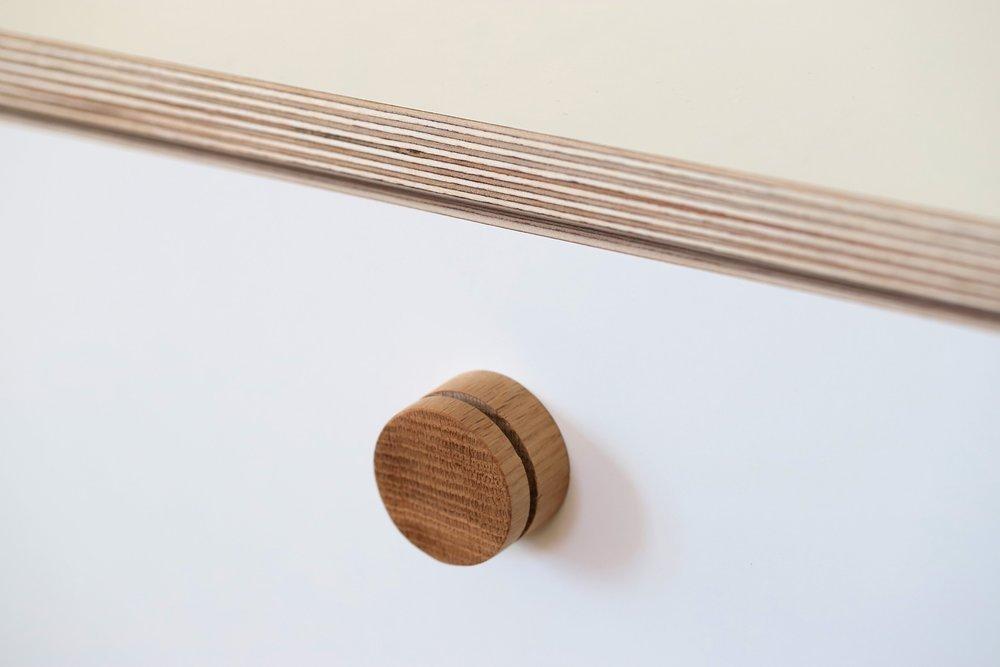 The oak dowel door handles.