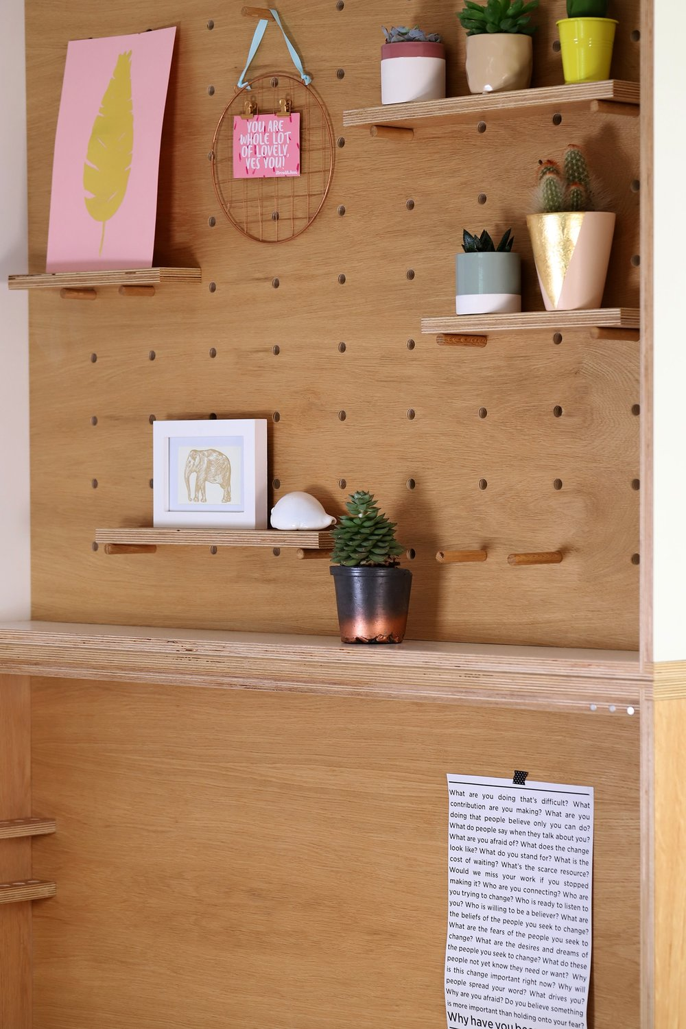 The modular peg board allows the family to display sentimental items or leave notes.