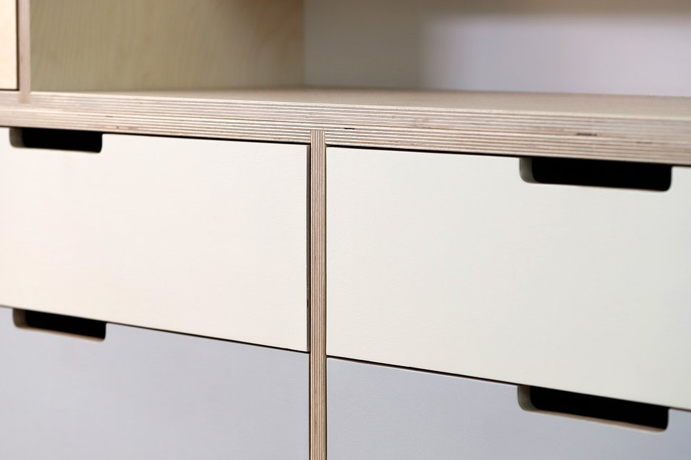 The ombre painted drawers underneath the plasma screen.