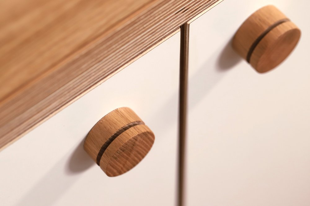 A close up of the oak dowel handles.
