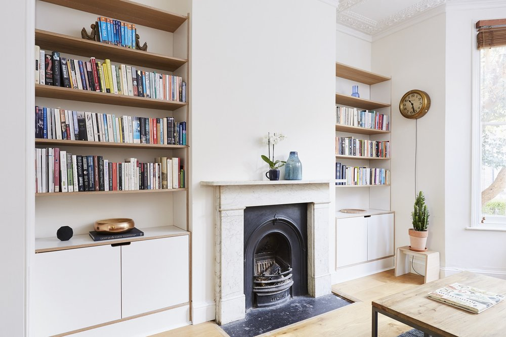 Front view of Cass's laminated birch plywood bespoke alcove shelving in Dalton London by Lozi