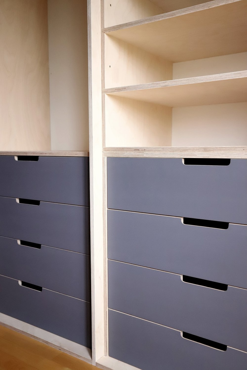 Ample drawer space allows the couple to easily store all their clothing.