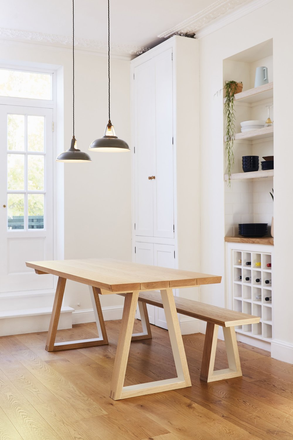 Cass's graphic solid oak and plywood bench offsets her majestic yet homely kitchen table.