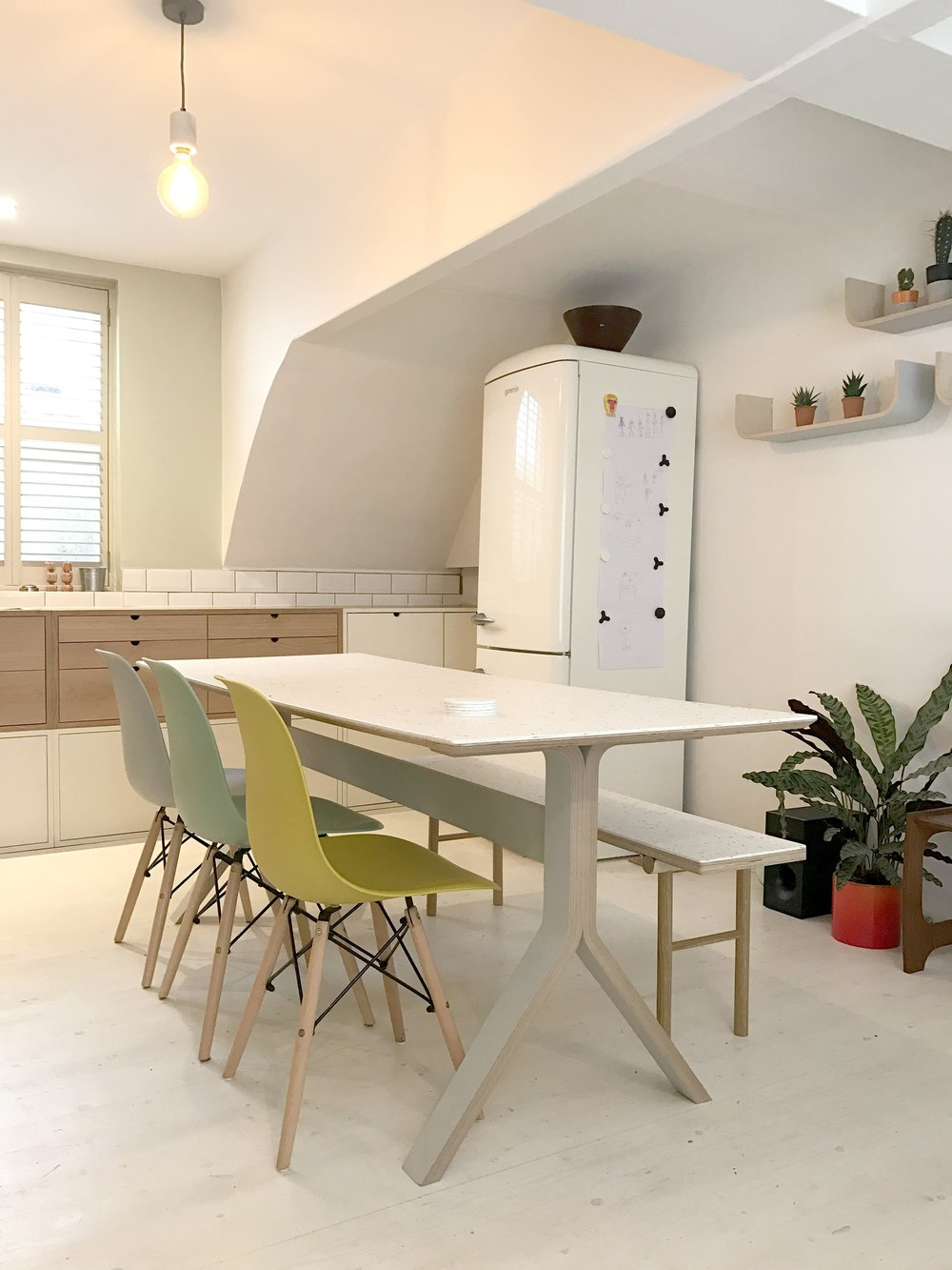 A bespoke Wave Bench, with recycled yogurt pot surface, matches Anna & Kirsty's Sea table in their Brighton kitchen.