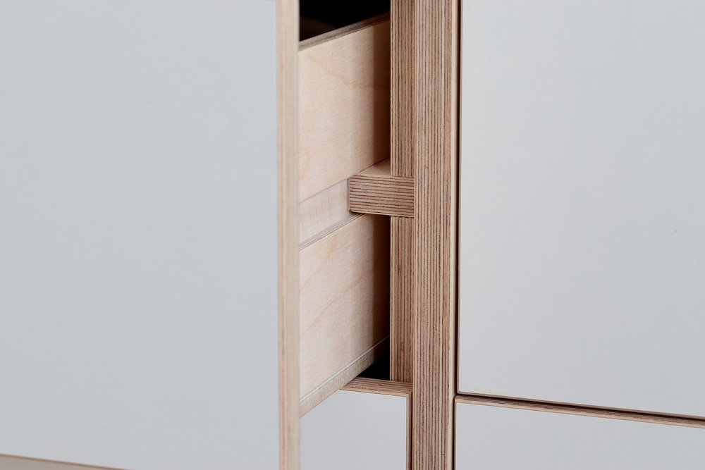 Drawer runner detail from Ilaria's bespoke plywood wardrobe designed by Lozi in her home in East London