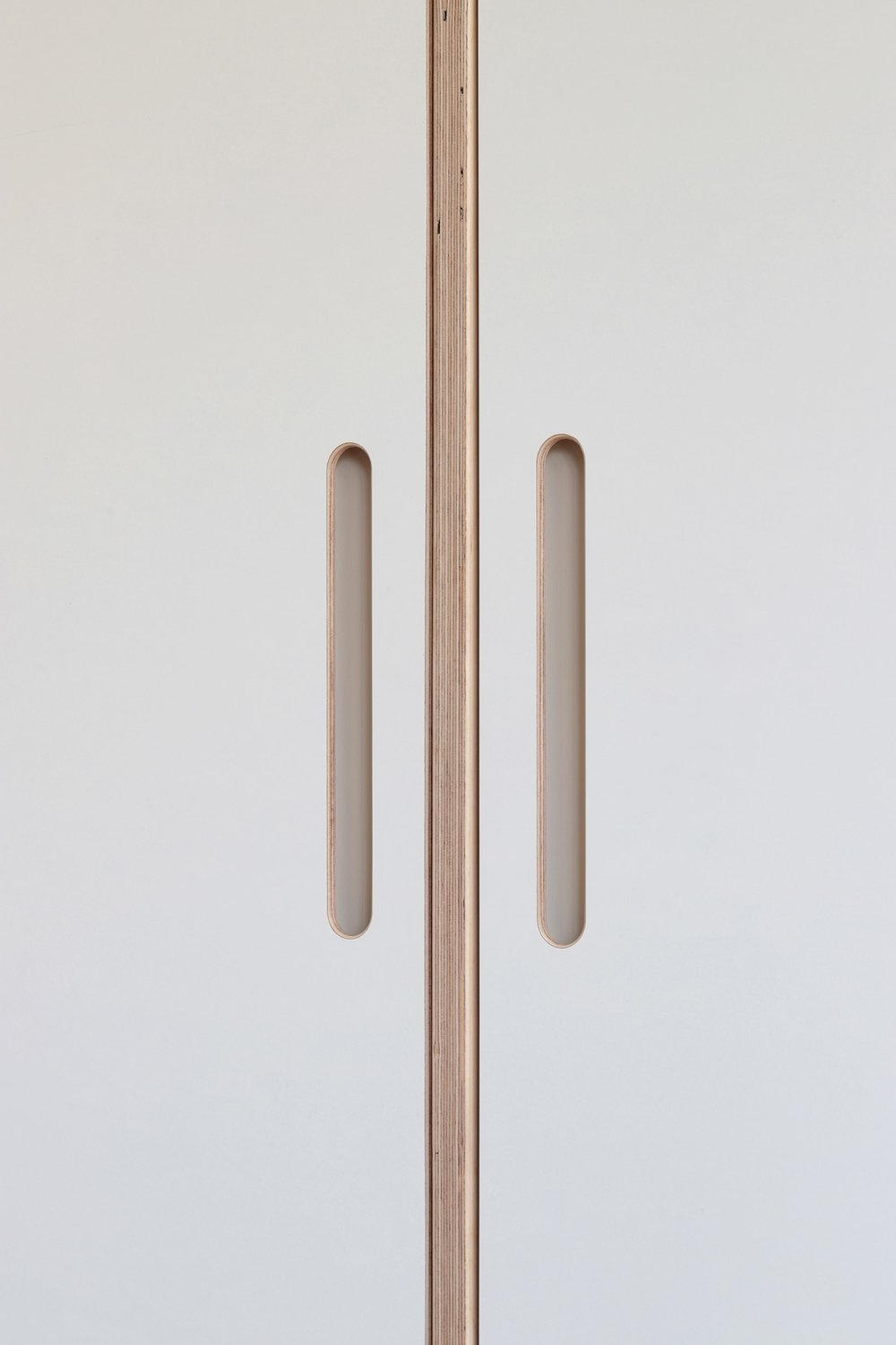 Handle detail from Ilaria's bespoke plywood wardrobe designed by Lozi in her home in East London